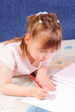 Attractive little girl draws picture Stock Photo