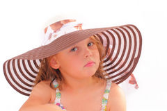 Attractive little girl in a hat Stock Photos