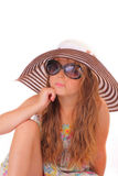 Attractive little girl in a hat and with sunglasses Stock Photography