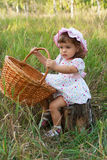 Attractive little girl holding a basket Royalty Free Stock Photo