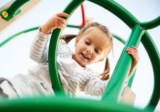 Attractive little girl on  playground Royalty Free Stock Photos