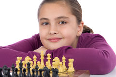 Attractive little girl playing chess Stock Image