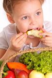 Attractive little girl with vegetables and fruits Stock Photography