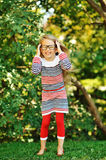 Attractive little girl wearing glasses Stock Images