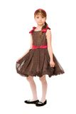 Attractive little lady in a brown dress Royalty Free Stock Image
