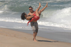 Attractive lovely couple on the beach Royalty Free Stock Images