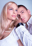 An attractive lovely couple in romancing posing. Studio shot Stock Images
