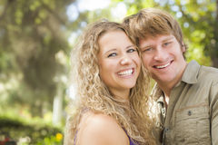 Attractive Loving Couple Portrait in the Park Royalty Free Stock Photography