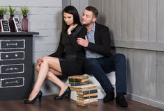Attractive loving couple in a stylish interior. Stock Photography
