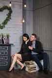 Attractive loving couple in a stylish interior. Royalty Free Stock Photos