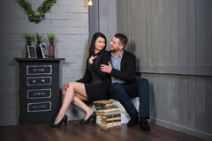 Attractive loving couple in a stylish interior. Stock Images