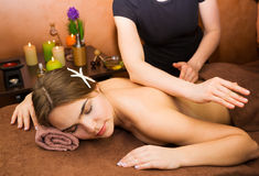 Attractive lying young woman in spa salon Stock Images