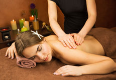 Attractive lying young woman in spa salon Stock Image