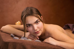 Attractive lying young woman in spa salon Stock Photography