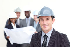 Attractive male architect with his team Stock Photography