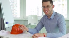 Architect smiles at the table royalty free stock photography