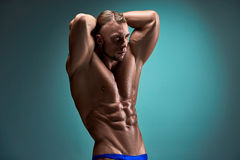 Attractive male body builder on blue background Stock Photo