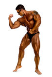 Attractive male body builder, demonstrating contest pose Royalty Free Stock Image