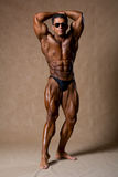 Attractive male body builder, demonstrating contest pose Stock Photography