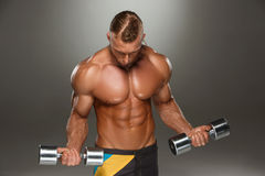 Attractive male body builder on gray background Stock Photo