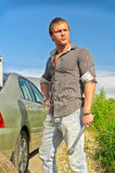 Attractive male changing tires Stock Photo