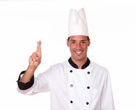 Attractive male chef with luck sign Royalty Free Stock Photo