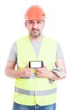 Attractive male constructor showing phone with empty screen Royalty Free Stock Image