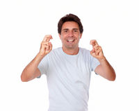 Attractive male crossing fingers for luck Stock Images