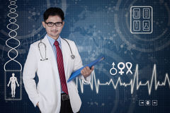 Attractive male doctor with document Stock Photo