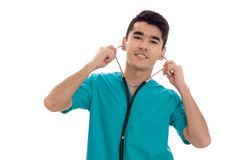Attractive male doctor in uniform with stethoscope smiling on camera isolated on white background Stock Image