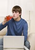 Attractive male drinking Stock Images