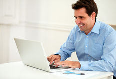 Attractive male entrepreneur working on his laptop Royalty Free Stock Images