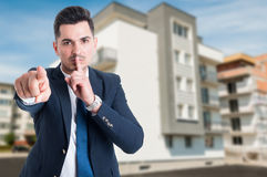 Attractive male estate broker doing a quite gesture Stock Images