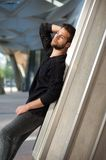 Attractive male fashion model with beard posing outdoors Royalty Free Stock Photography