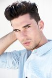 Attractive male fashion model with hand in hair Royalty Free Stock Image