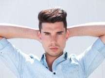 Attractive male fashion model with hands behind head Stock Photography