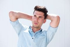 Attractive male fashion model with hands in hair Royalty Free Stock Image