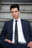 Attractive male fashion model sitting on stairs Royalty Free Stock Photo