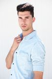 Attractive male fashion model standing on white background Stock Photography