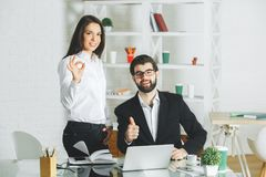 Attractive male and female showing thumbs up Stock Images