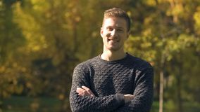 Attractive male laughing and looking at camera, posing for dating agency profile. Stock photo royalty free stock images