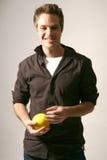 Attractive Male Model in Studio Setting. Male Model in a Studio Setting playing with ball stock photography