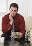 attractive male newspaper reading στοκ εικόνες