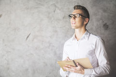 Attractive male with notepad Stock Image