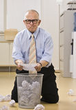 Attractive male senior searching the garbage. Royalty Free Stock Images