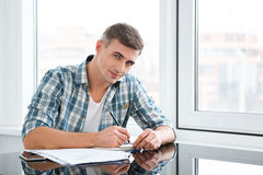 Attractive male sitting and working in the office Stock Photos