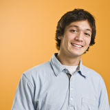 Attractive male smiling. At camera, torso shot. Wearing a blue button down. Square Stock Images