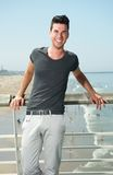 Attractive male smiling at the beach Royalty Free Stock Images
