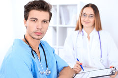 Attractive male surgeon doctor in hospital. Medicine and health care Stock Image