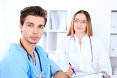 Attractive male surgeon doctor in hospital. Medicine and health care concept Royalty Free Stock Photos